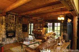with large stones surrounding the fireplace and big logs along the ceiling everything looks simple and natural