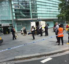 Image result for Belgian shopping mall evacuated as three gunmen rob jewelry store