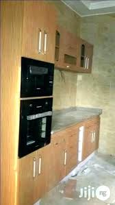 how to repair ling veneer on particle board cabinets how to particle board kitchen cabinets how particle board