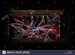 old fuse box mess of wires cables colored coded running in old fuse box mess of wires cables colored coded running in crazy directions in haphazard messy disorganized confusion