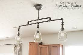 finished photo of diy light fixture made using ldr pipe and 3 glass globes