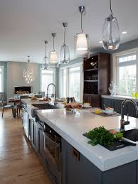 appealing pendant lighting with white granite countertop and dark wooden flooring plus glass window and wood shelves for mid century modern kitchen design appealing pendant lights kitchen