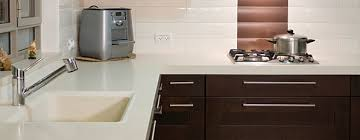 synthetic surfaces are a man made plastic material that gives countertops an ultra modern clean look and feel it comes in many colours and designs