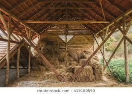 inside barn background. dry hay stacks in rural wooden barn interior inside background g