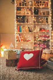 Living room decorated with christmas lights and presents by Dejan Ristovski  for Stocksy United