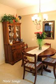 we brought over the little round table and chairs from the breakfast room from the sold house it s a teeny little space as you can see so the little