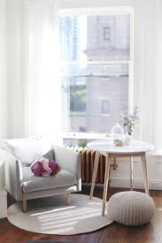 airy studio space decor tips with marble coffee table grey minimalist armchair jute rug
