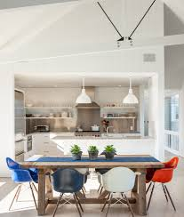 white cabana dining room beach style with wooden dining table eames molded plastic armchair white kitchen