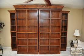 bookcases hide a murphy bed bookcases swing open to reveal bed side bookcases on each side provide additional storage