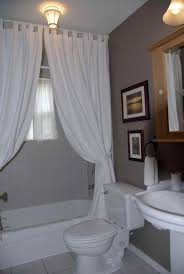 half bathroom ideas gray. Astounding White Fabric Tub Curtain Added Portray Over Toilet And Wooden Floating Medicine Cabinet Mirrored Pedestal Sink In Gray Half Bath Ideas Bathroom R