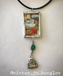 no mud no lotus double sided glass and solder pendant