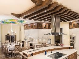 wood ceiling lighting. Kitchen Ceiling Treatment Made Custom Aspen Beams Hangs Above The Island. Wood Lighting