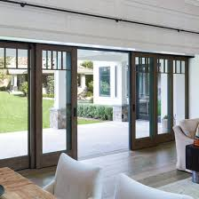 traditional pella dark wood multi panel sliding patio doors open