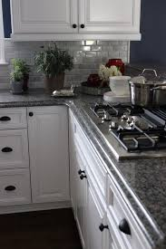 Delightful Lindsey Paris Of Atlanta, Updated Her 20 Year Old Kitchen With White Solid  Wood Door Fronts And Replaced The Laminate Counters With Granite.