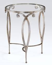 round hand wrought iron table with scroll design antique silver leaf finish and glass