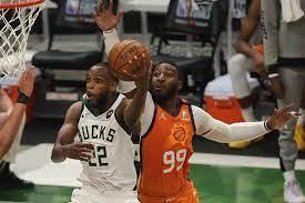 Khris Middleton sends Bucks past Suns ...