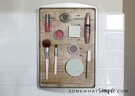 diy magnetic makeup organizer from a dollar cookie tray