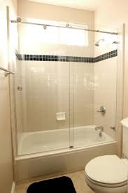 tub glass shower enclosure is a nice construction with a bath tub which is closed with the glass doors the shower facilities are placed inside it