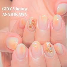 Ginza Bonny旭川店さんのネイルデザイン 夏色オレンジとイエローの