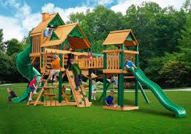 this set includes a standard ladder rock wall and climbing rope ladder and slide attached to the main tower this tower is connected to a smaller