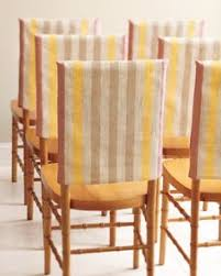 fabric slipcovers for chairs turn a tote sans strap upside down for instant chair decor choose this pink and yellow scheme for a tropical or desert locale