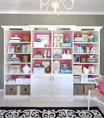 Create a built in bookshelf wall in your living room by mixing and matching  together IKEA