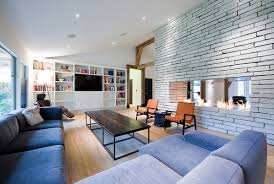 trendy large living room with l shaped seating arrangement fireplace and built ins