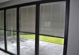 integral blind system within a four panel set of aluminium bi folding door from idsystems