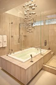 master bathroom ideas with modern chandeliers bathroom lighting lighting design drop above oval bath tub unify claws foot ideas
