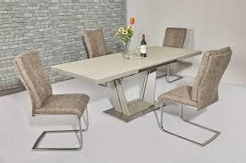 matt cream gl dining table and 8 cream fabric chairs