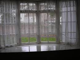 hanging curtains on a bay window fresh net curtain rods for upvc bay windows