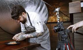 san francisco chef brett cooper puts the finishing touches on a dish at coi restaurant in