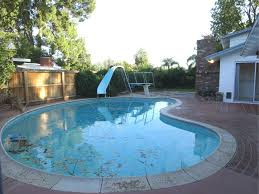 inground pools with diving board and slide. Large And Deep Inground Pool With Fun Slide Professional Diving Board. Photo Was Taken Pools Board L