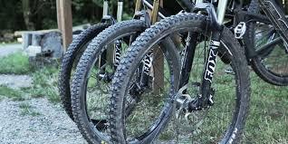 three mountain bikes