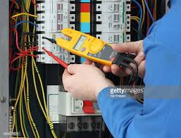 fuse box stock photos and pictures getty images electrician testing for voltage in a fuse box