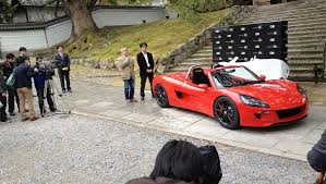 photo electric sports car unveiled in kyoto