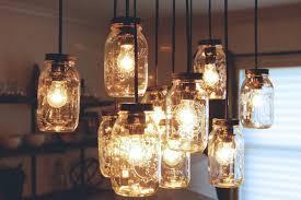 frosted mason jar chandelier lighting in a vintage canning basket for 2015 christmas mason jar crafts 2015 outdoor decor ideas betty 8 light mason jar