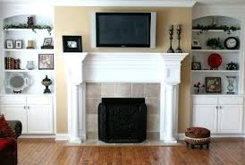 tv over mantle custom home family room flat screen mounted over fireplace hand carved mantle built