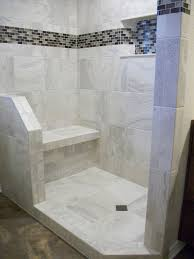 white porcelain tile shower with tile bench and angled curb and half wall
