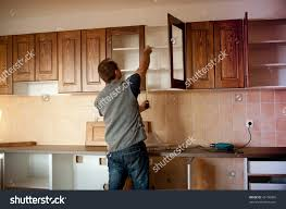Carpenter Kitchen Cabinet Carpenter Working On New Kitchen Cabinets Stock Photo 43156006