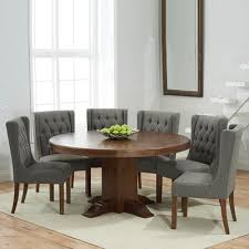 trina dark solid oak round dining table with 6 sophia grey chairs