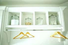 wall mount clothes rod rack to hang in laundry room wardrobe racks pull down closet wall mount clothes rod