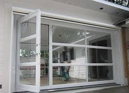 Modle De Porte Garage Vitre Avec Une Piton Intgre  Glass Door Model With An Integrated Pedestrian  Crdit Photo