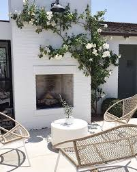 white outdoor furniture. patio fireplace white brick would be acceptable in this case provided the roses are red outdoor furniture e