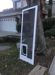 image of dog door screen door home depot