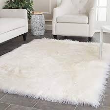 A Safavieh Faux Silky Sheepskin FSS235A Ivory Area Shag Rug 4u0027 X