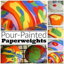 pour painted paper weights from beach stones a fun art process and a great
