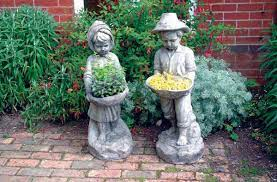 swain boy and swain girl stone statues