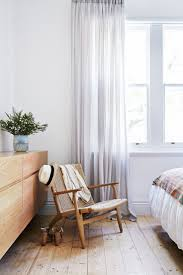 Sheer-linen curtains form part of the timeless appeal of this three-bedroom  Edwardian house