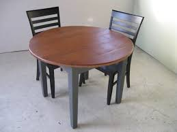 small round dining table and 2 chairs